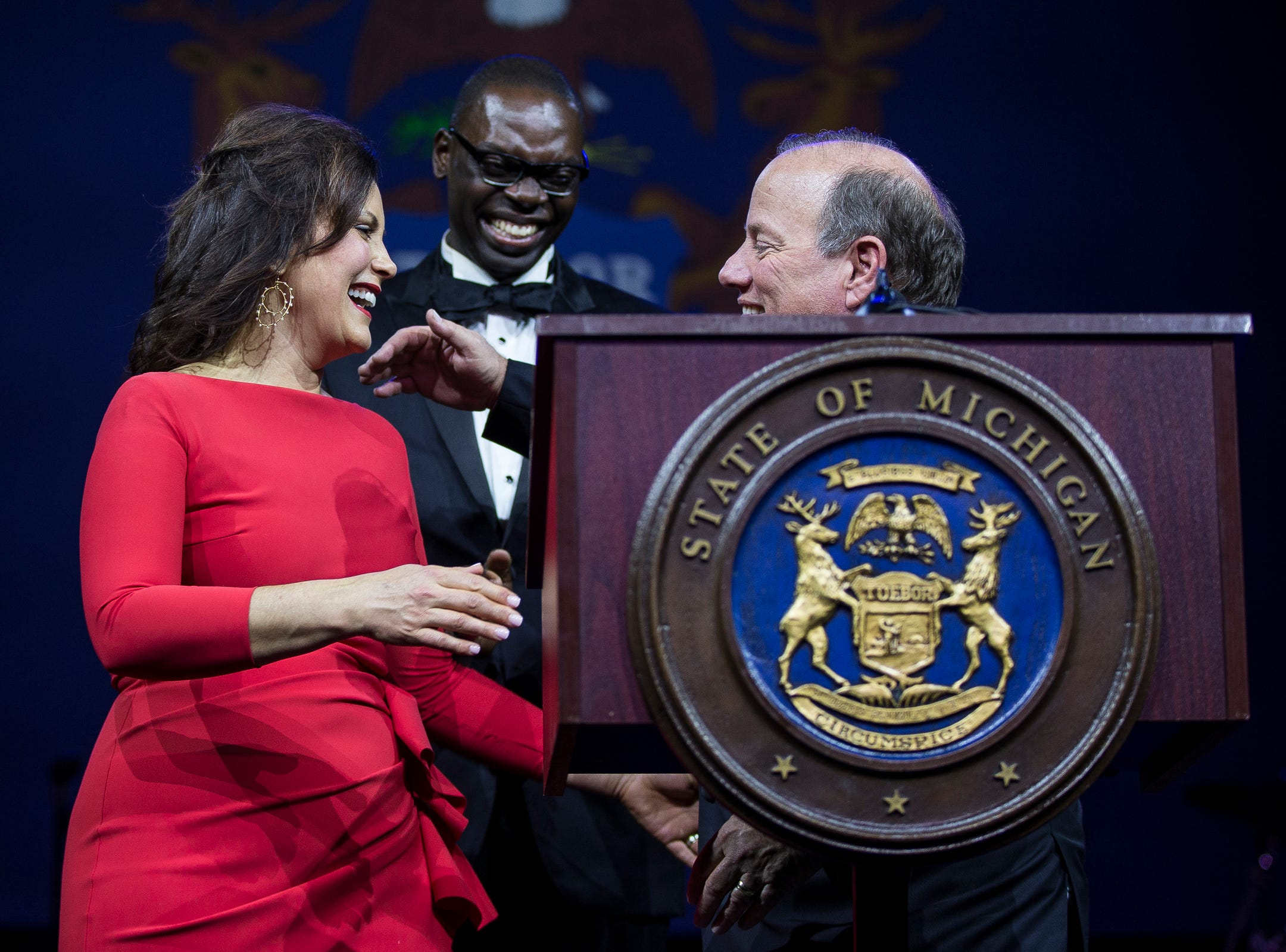 Governor Gretchen Whitmer hugs Detroit mayor Mike Duggan during the inaugural ball at Cobo Center in Detroit on Tuesday, Jan. 1, 2019.