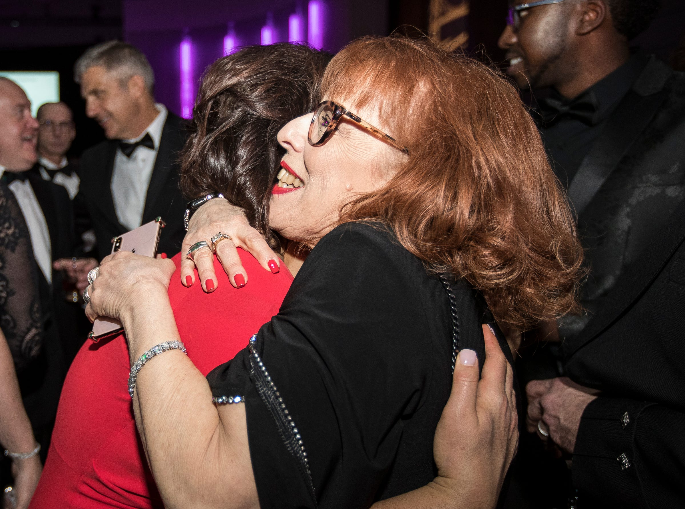 Governor Gretchen Whitmer hugs Sharon Baseman of Huntington Woods during the inaugural ball at Cobo Center in Detroit on Tuesday, Jan. 1, 2019.