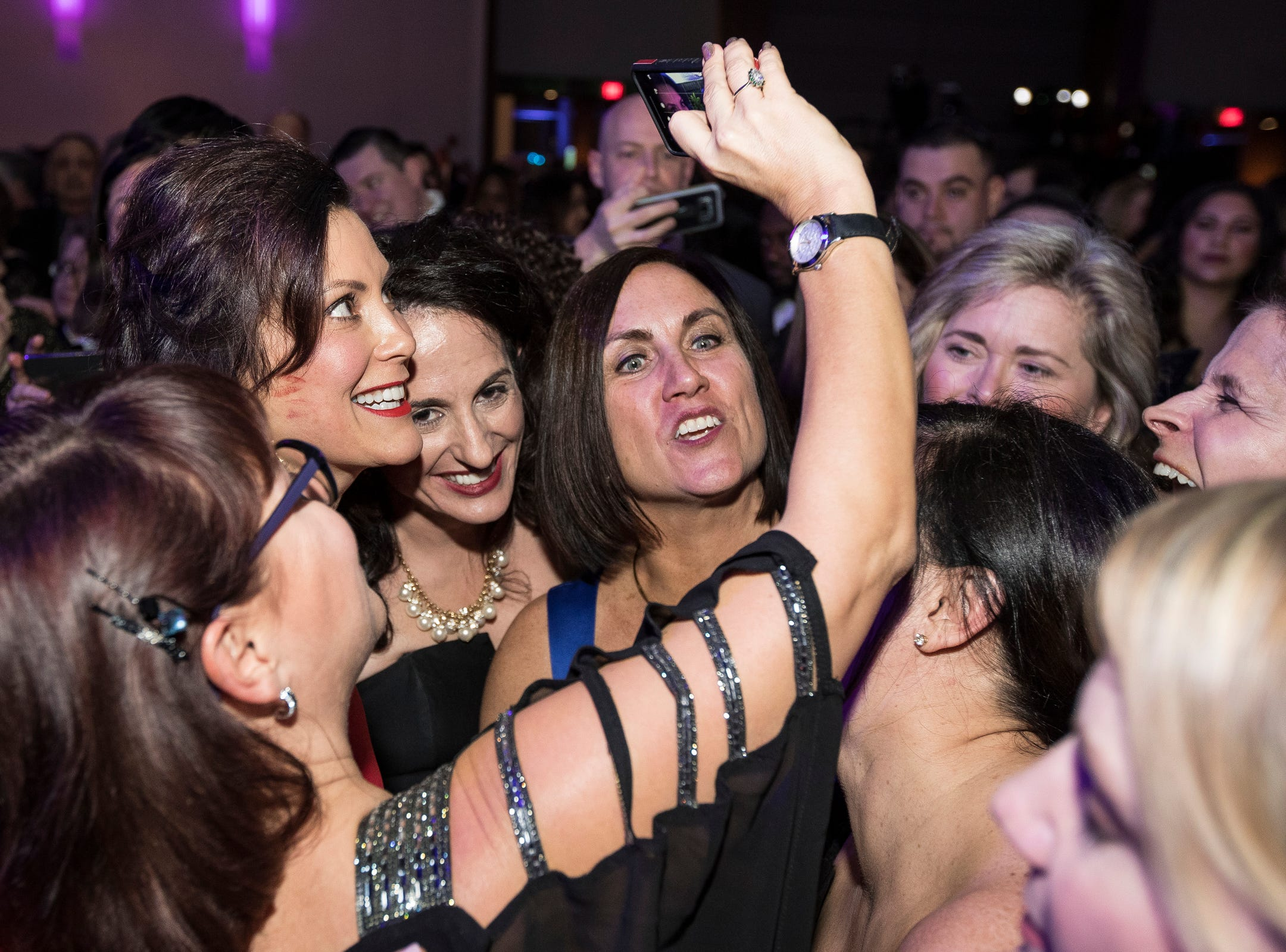 Governor Gretchen Whitmer takes a selfie with her sorority sisters from Michigan State University's Kappa Alpha Theta during the inaugural ball at Cobo Center in Detroit on Tuesday, Jan. 1, 2019.