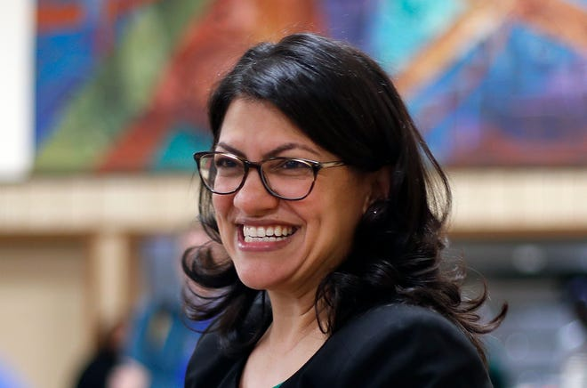 """Newly sworn-in Rep. Rashida Tlaib of Detroit told a cheering crowd that """"we're going to ... impeach the (expletive),"""" referring to President Donald Trump."""