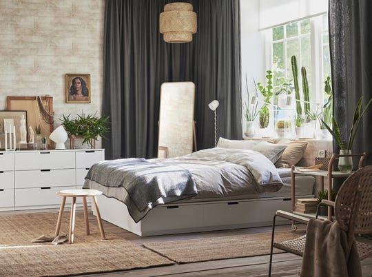 A Scandinavian bedroom is meant to be a retreat and place to get a good night's sleep. The space should be a place to relax with cozy bedding, window treatments for light control and task lighting centered above the bed to nestle in with your favorite book.