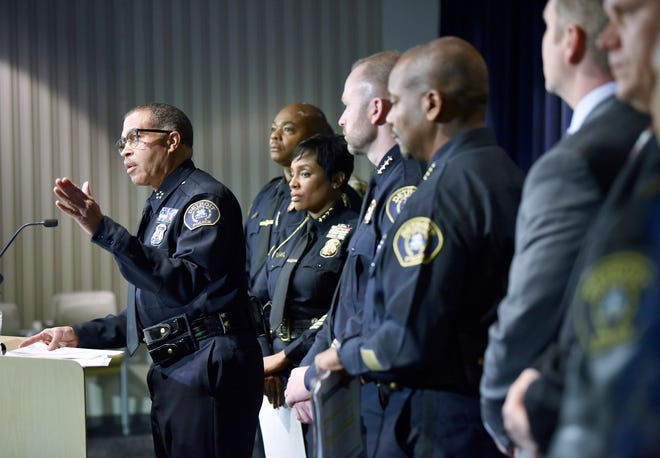 Detroit Chief of Police James Craig, left, stands with members of his command staff, federal agency officials and civilian group members as he talks about Detroit's crime statistics Wednesday at DPD Public Safety Headquarters.