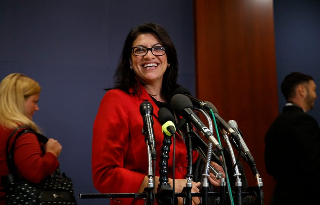 Rep.-elect Rashida Tlaib, D-Mich., pauses to speak to media as she walks from member-elect briefings and orientation on Capitol Hill in Washington, Nov. 15, 2018.