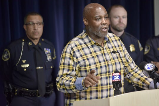 Flip the Script Director Keith Bennett, center, addresses the media as DPD Chief James Craig, left, and Assistant Chief David LeValley, right, listen.