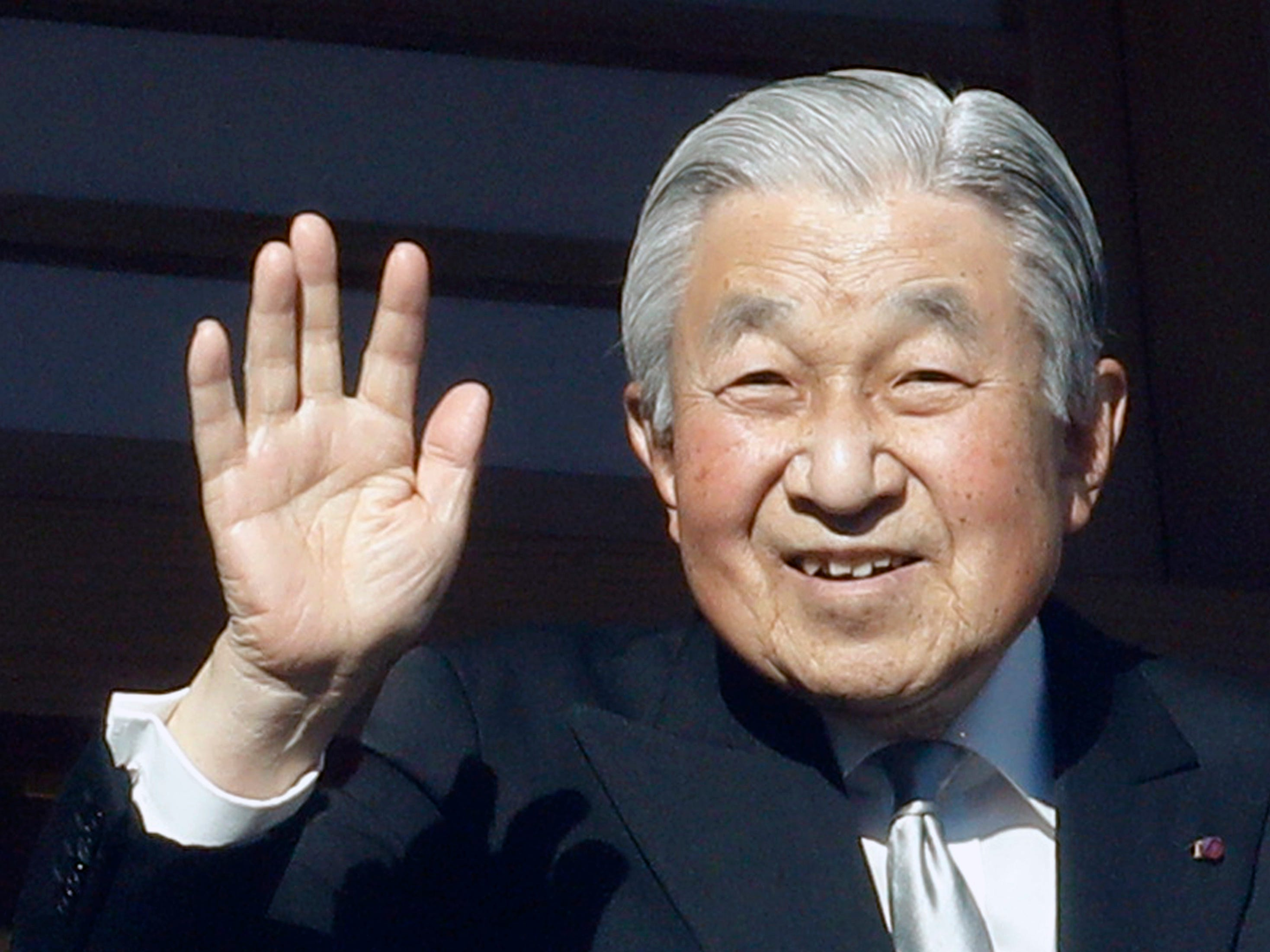 Japan's Emperor Akihito waves to well-wishers from the bullet-proofed balcony during his New Year's public appearance with his family members at Imperial Palace in Tokyo Wednesday, Jan. 2, 2019.