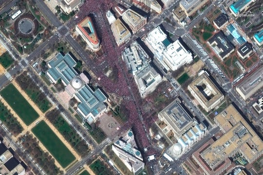 "This March 24, 2018 satellite image provided by DigitalGlobe shows crowds at the ""March for Our Lives"" demonstration in Washington."