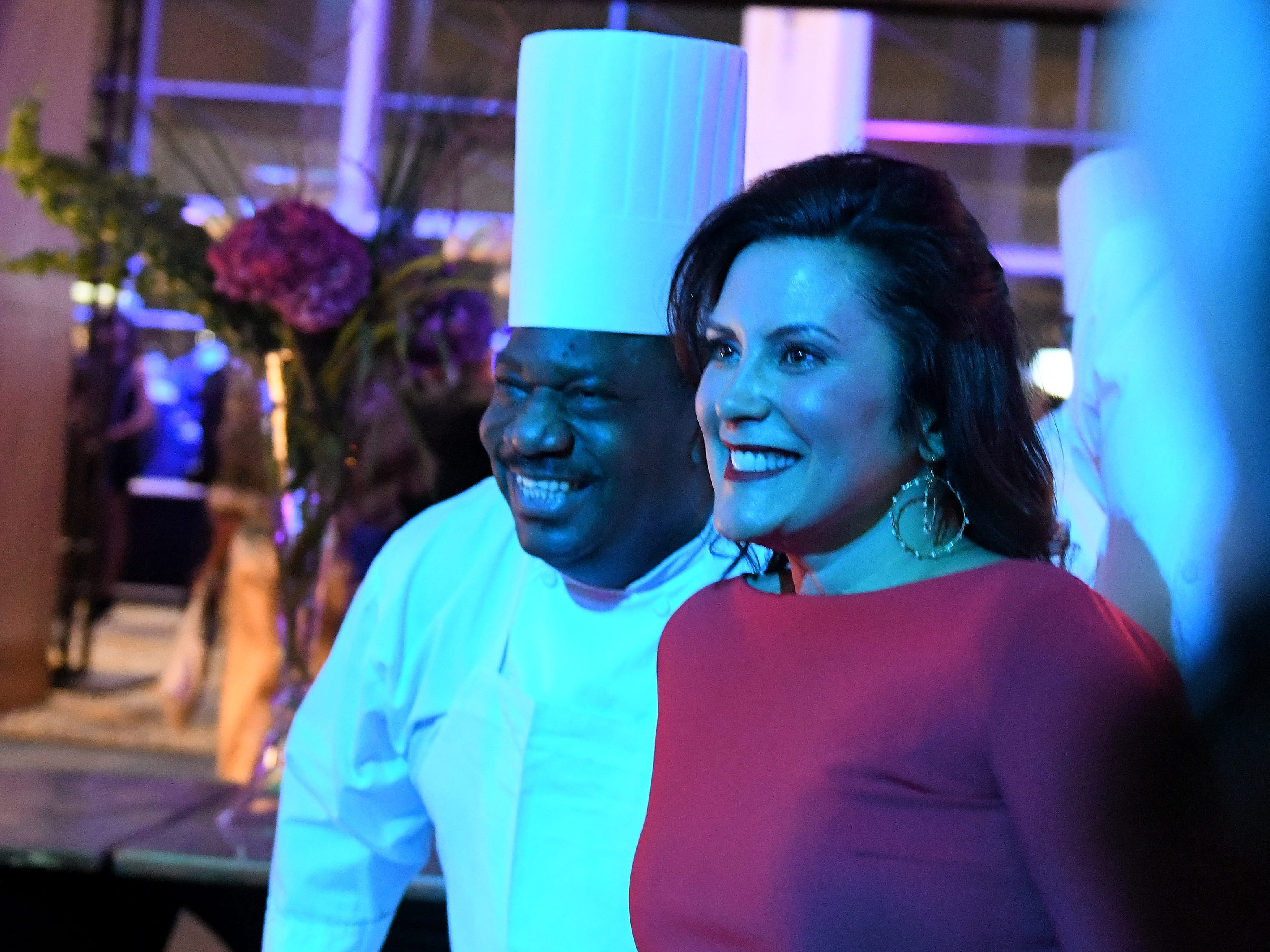 Gov. Gretchen Whitmer makes time for a photo with Chef Guy Richardson while serving food at the inauguration celebration.