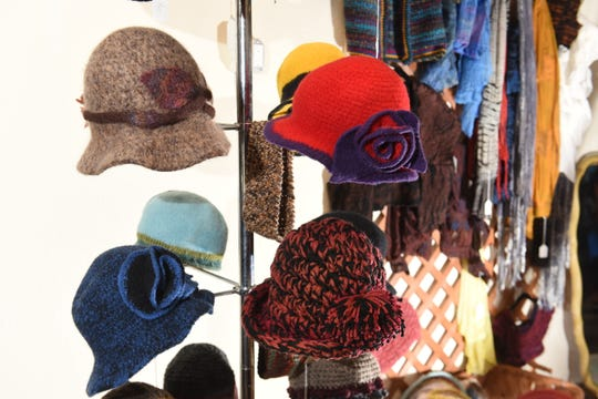 Felted hats are on display at Curvie's Hats, Etc.