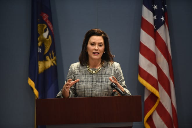 Governor Gretchen Whitmer speaks to the news media moments after signing her first executive directive of her administration.