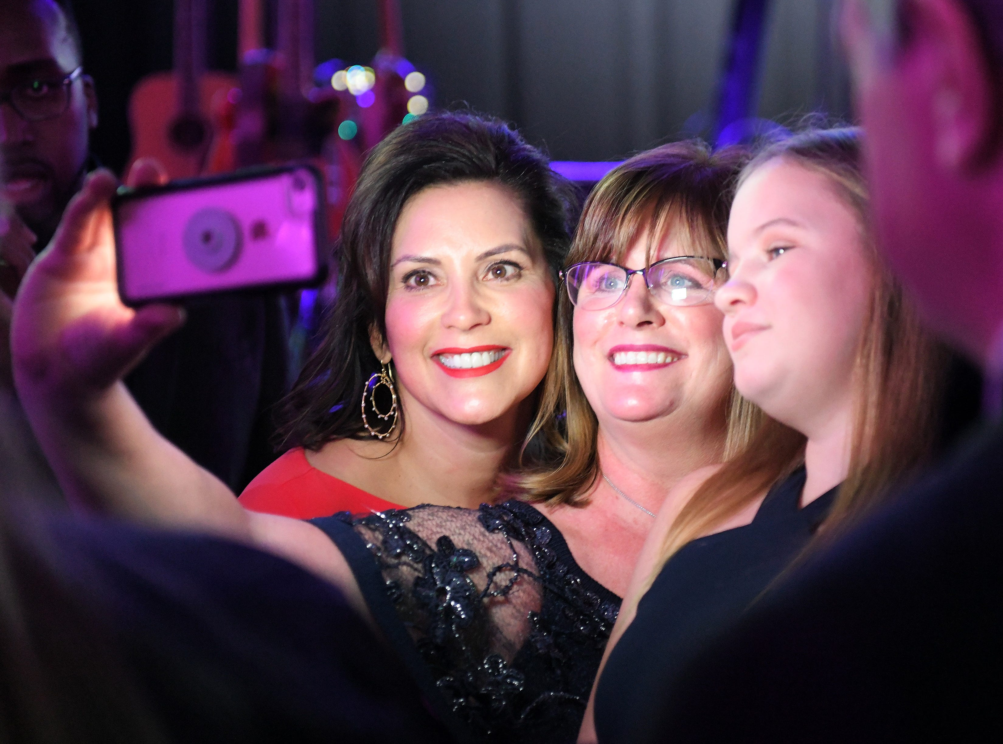 Gov. Gretchen Whitmer left, takes a photo with Aimee  Cowher of Grosse Pointe Farms and her daughter, Abi Cone, 15,  at the inauguration celebration in the Grand Riverview Ballroom at Cobo Center in Detroit on Jan. 1, 2019.