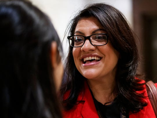 Rep.-elect Rashida Tlaib talks with a reporter between sessions during member-elect briefings and orientation on Capitol Hill in Washington, Nov. 15, 2018.