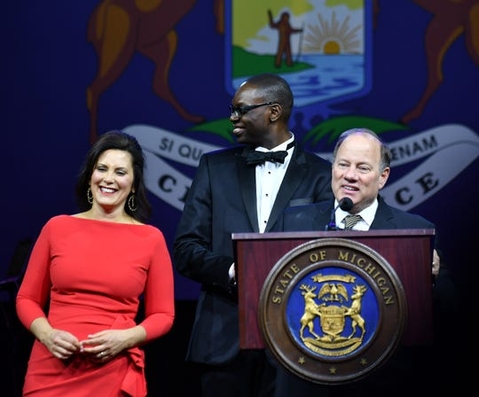 Detroit mayor Mike Duggan, right, introduces Gov. Gretchen Whitmer, left, and Lt. Gov. Garlin Gilchrist II,    at the Inauguration Celebration in the Grand Riverview Ballroom at Cobo Center in Detroit on Jan. 1, 2019.