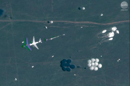 This Sept. 13, 2018 satellite image provided by DigitalGlobe shows an airborne paradrop during the Vostok military exercises in the Eastern Siberia area of Russia.