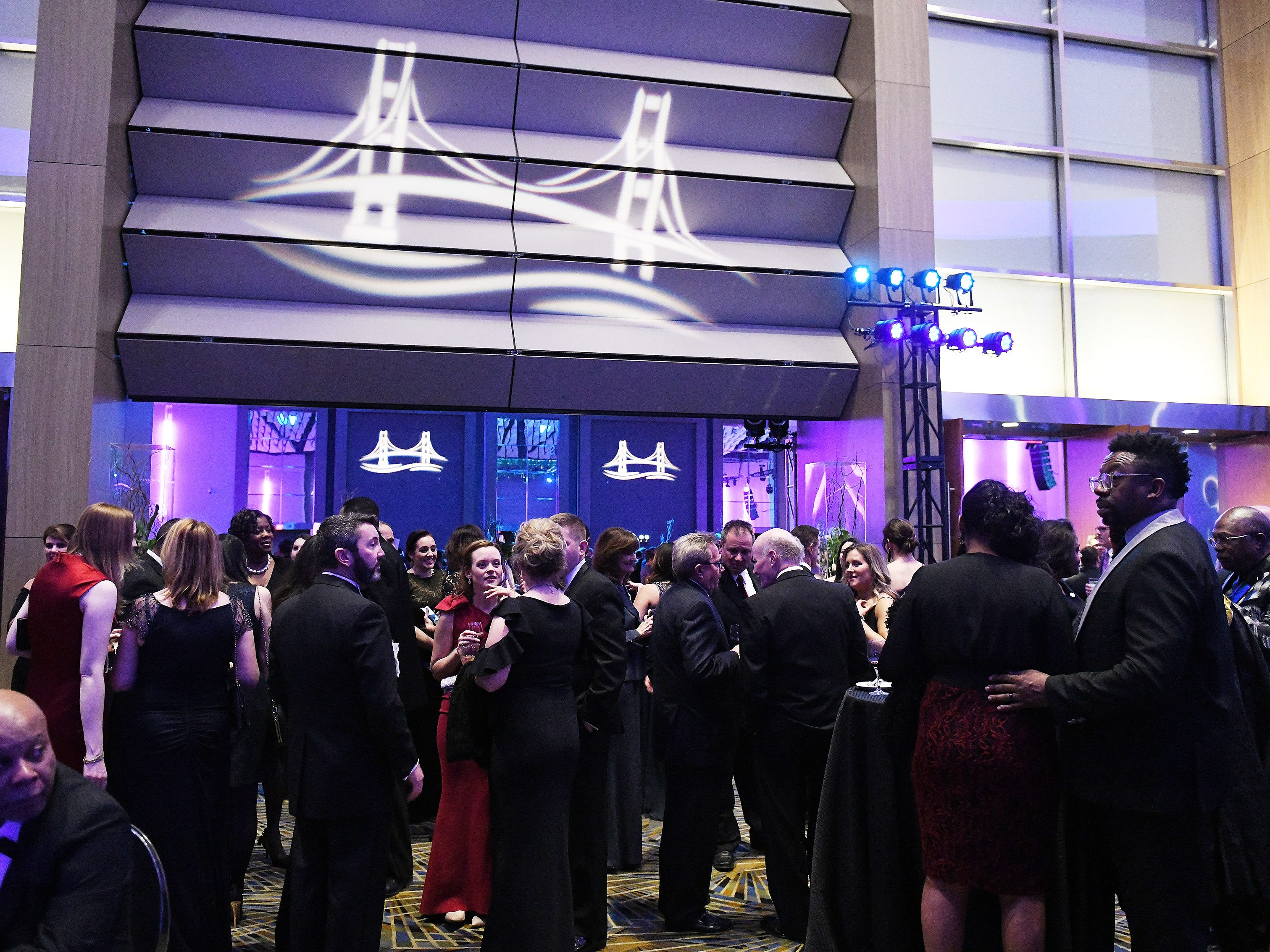 Attendees gather around and in the Grand Riverview Ballroom at the Inauguration Celebration at Cobo Center.
