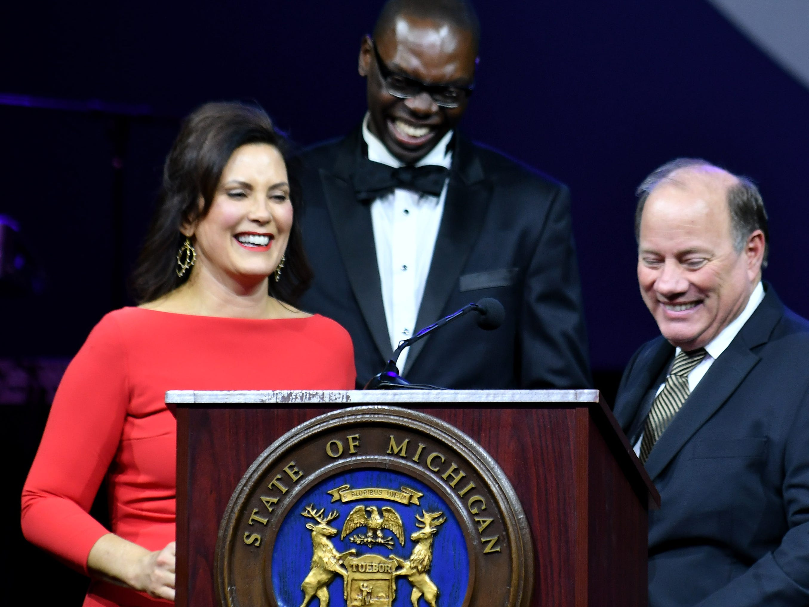 Detroit Mayor Mike Duggan, right, introduces Gov. Gretchen Whitmer and Lt. Gov. Garlin Gilchrist II  at the inauguration celebration.
