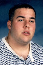 Brad Polk was a first-team all-state football player at Elmira Notre Dame in 1996.