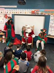 Reading with Santa at Bataan Memorial Primary was held on Dec. 19. Port Clinton High School National Honor Society members organize the event each year.
