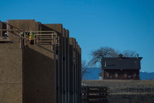 Construction crew members work on the 368 apartments on Wednesday, Jan. 2, 2019, near the intersection of East Harmony Road and Strauss Cabin Road in Fort Collins, Colo.