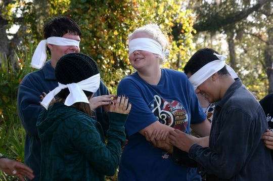 Blindfolded students take part in team building on a Peace River canoe trip. The Monday Group began in 1969. Students got involved in a number of conservation issues that help shape Lee County's environment.
