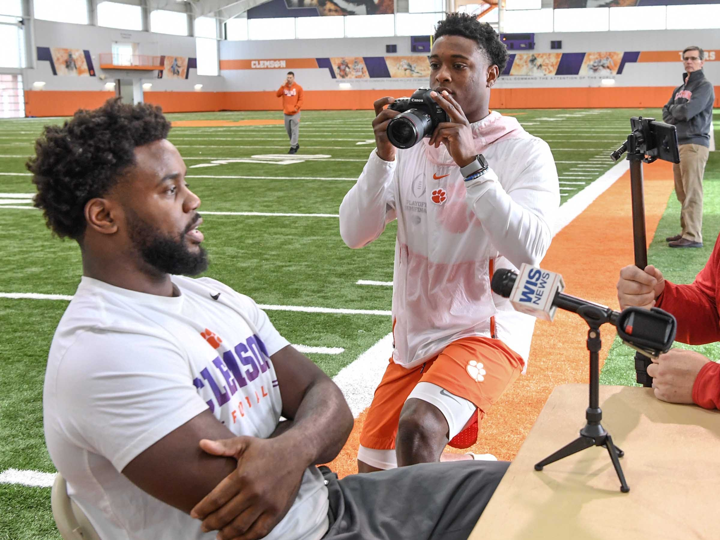 Clemson defensive back K'Von Wallace, right, gets a photograph of linebacker Kendall Joseph during media day in the Poe Indoor Facility in Clemson Wednesday, January 2, 2019.
