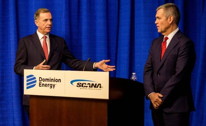 Thomas Farrell II, left, chairman, president and CEO of Dominion Energy, and Jimmy Addison, CEO of SCANA, speak during a press conference at SCANA in Cayce, SC.