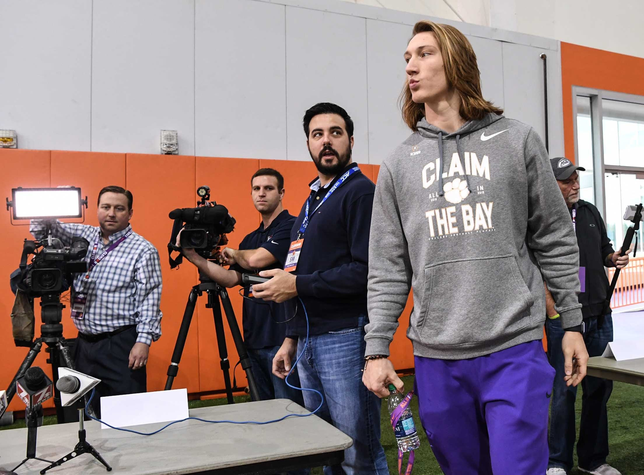 Clemson quarterback Trevor Lawrence walks in for media day in the Poe Indoor Facility in Clemson Wednesday, January 2, 2019.