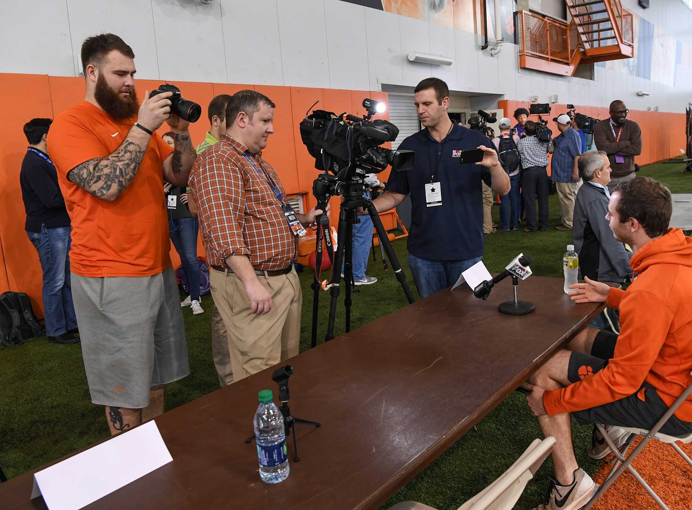 Clemson offensive lineman Sean Pollard, left, takes photos of wide receiver Hunter Renfrow, right, during media day in the Poe Indoor Facility in Clemson Wednesday, January 2, 2019.