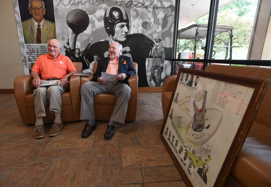 Former Clemson football players Fred Cone, left, and Phil Prince reminisce about their playing days as part of the Tigers' undefeated 1948 team.