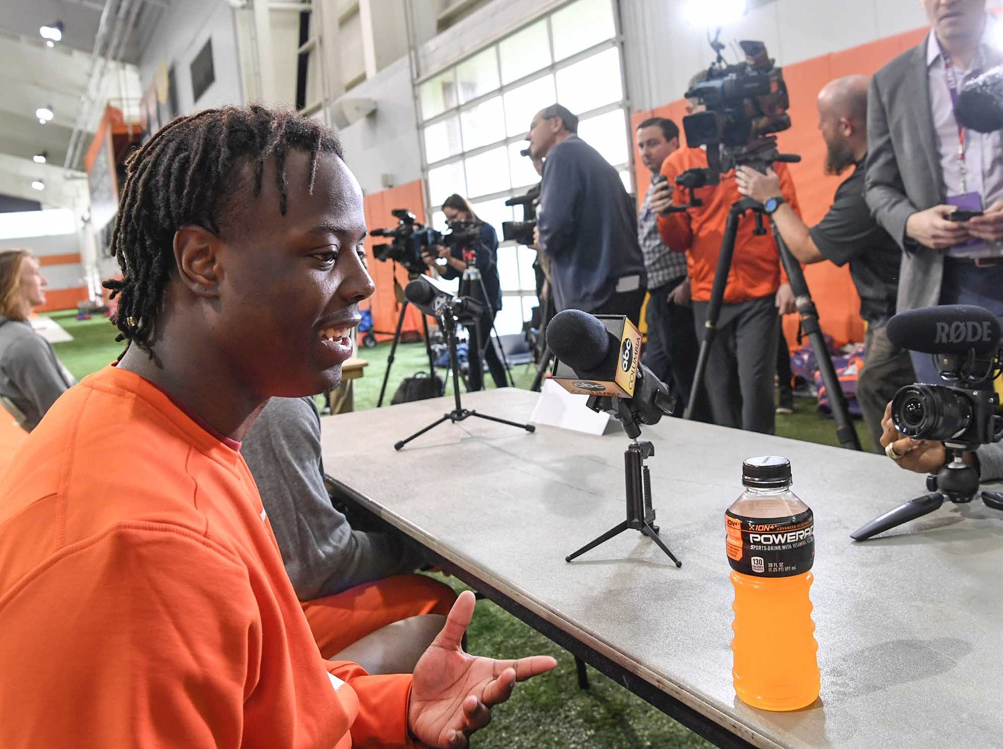 Clemson running back Travis Etienne talks during media day in the Poe Indoor Facility in Clemson Wednesday, January 2, 2019.
