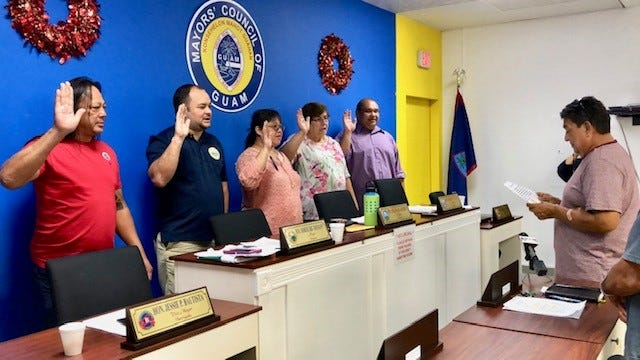 The new officers for the Mayors' Council of Guam, led by Dededo Mayor Melissa Savares as president and Sinajana Mayor Robert Hofmann as vice president, take their oath of office on Wednesday, Jan. 2, 2019. Effective immediately, mayors can now issue citations to residents for littering, illegal dumping, graffiti and other activities.