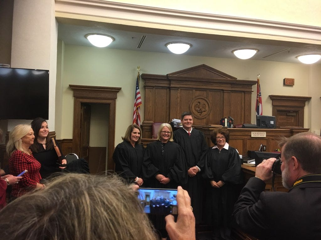 From left, chancellors Sheila Havard Smallwood, Rhea Sheldon, Chad Smith and Deborah Gambrell take the oath of office on Friday, Dec. 28, 2018.