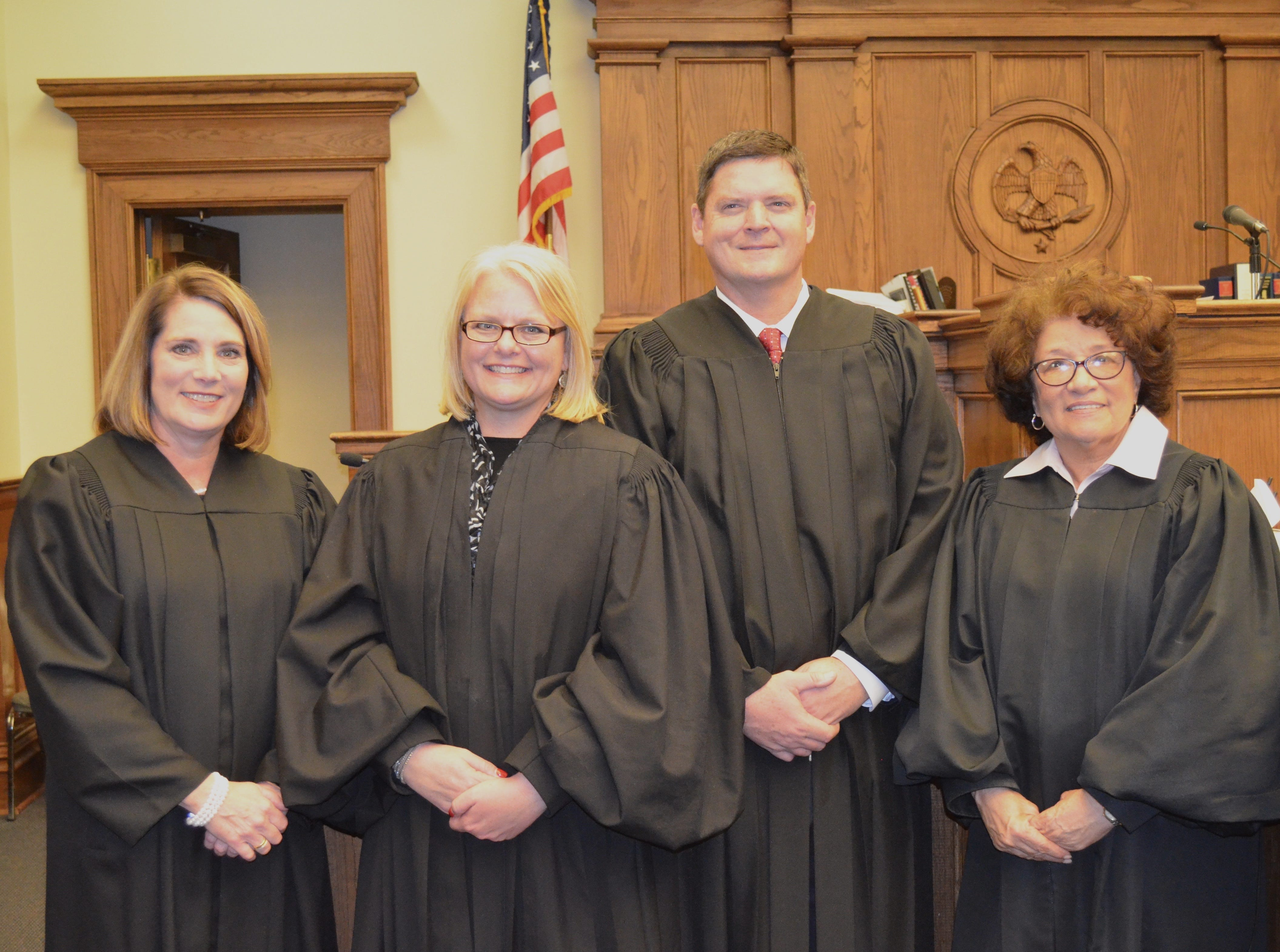 From left, Chancellors Sheila Havard Smallwood, Rhea Sheldon, Chad Smith and Deborah Gambrell take the oath of office on Friday, Dec. 28, 2018, at Forrest County Courthouse.