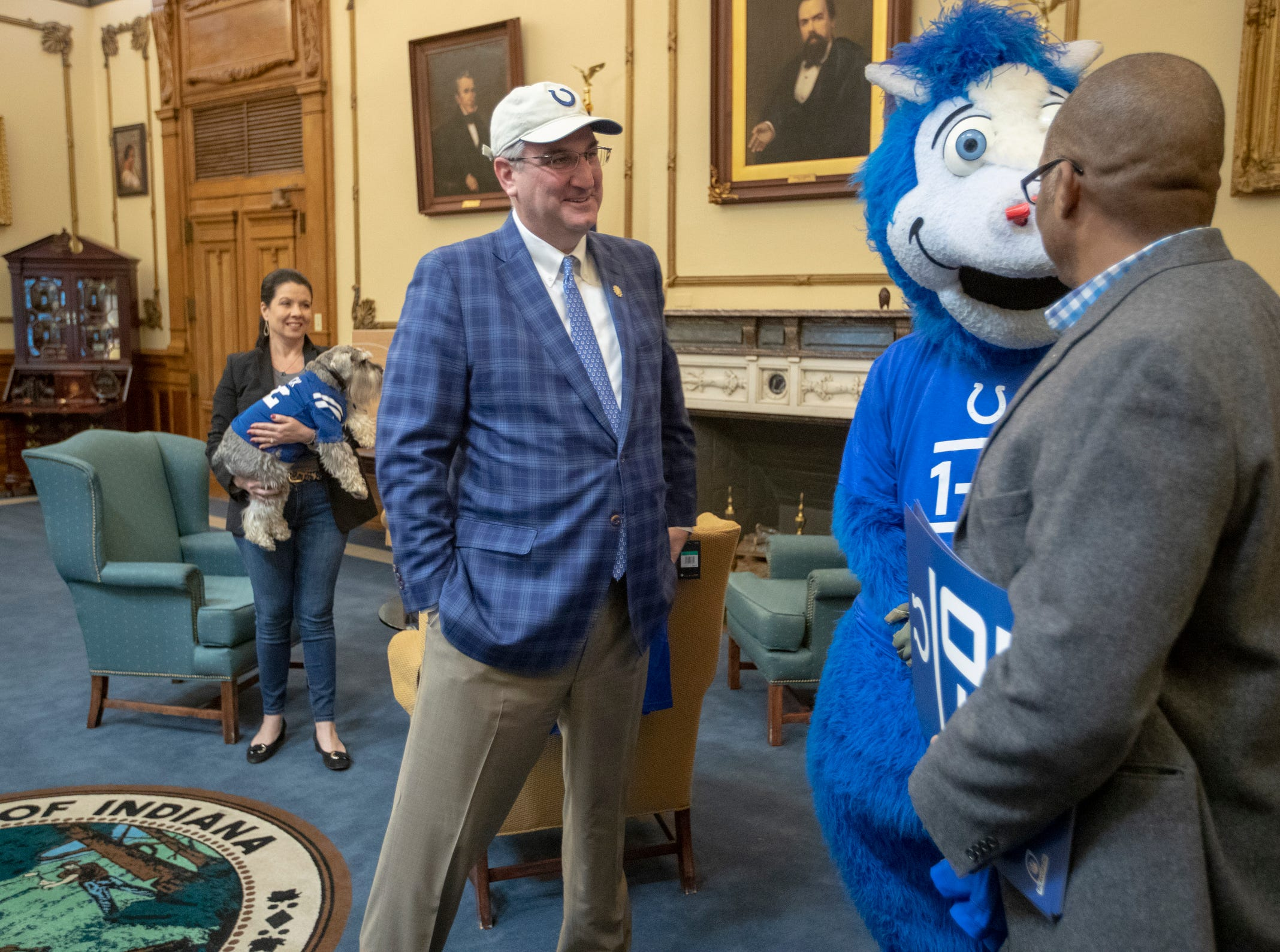 Eric Holcomb (left), visits with mascot Blue and Colts VP of Communications Steve Campbell, at Holcomb's office in the Indiana Statehouse, Indianapolis, Wednesday, January 3, 2019. The Colts have a Wild Card game this coming weekend against the Texans.