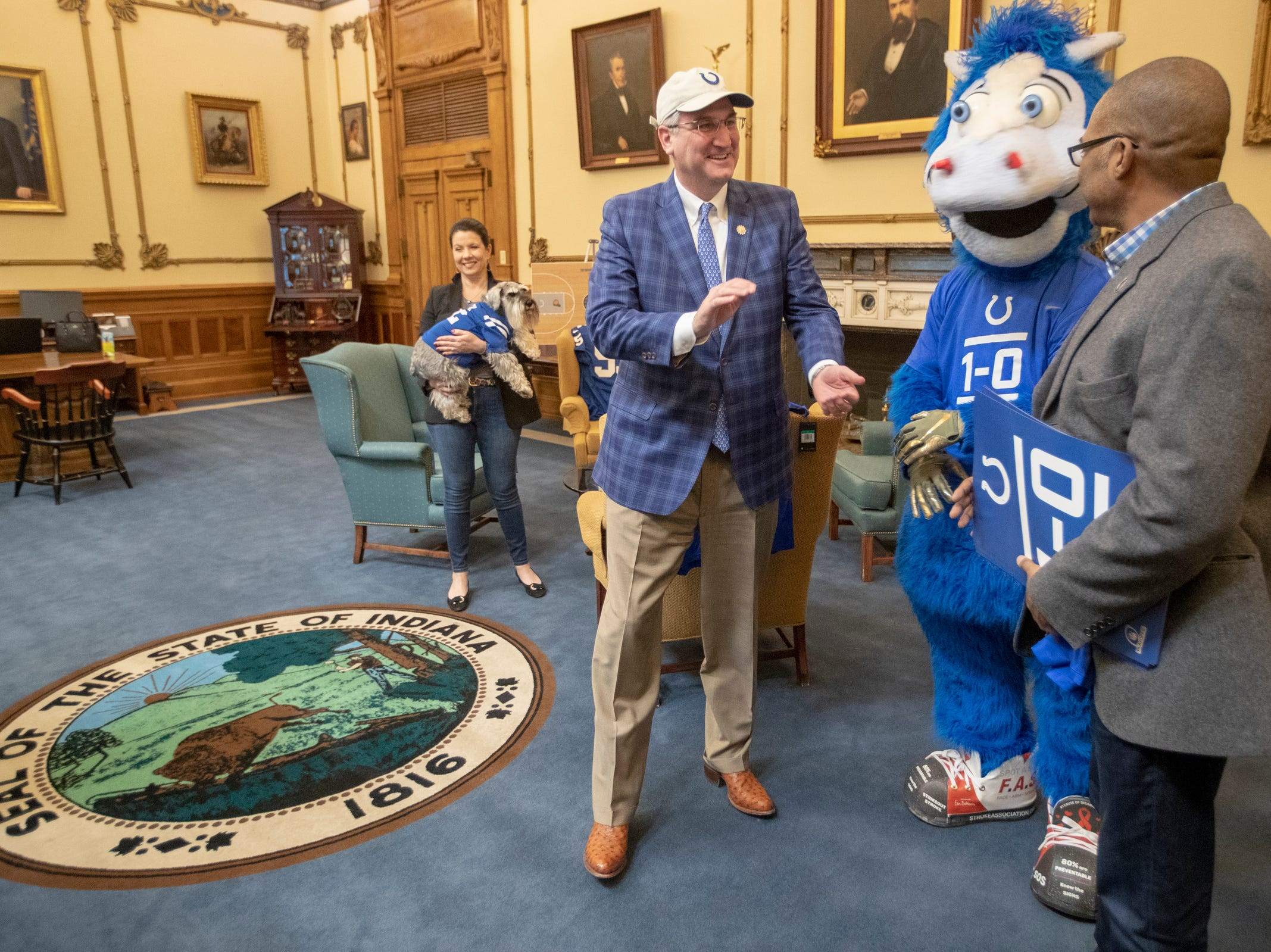 Janet Holcomb and Eric Holcomb, visit with mascot Blue and Colts VP of Communications Steve Campbell, at Holcomb's office in the Indiana Statehouse, Indianapolis, Wednesday, January 3, 2019. The Colts have a Wild Card game this coming weekend against the Texans.