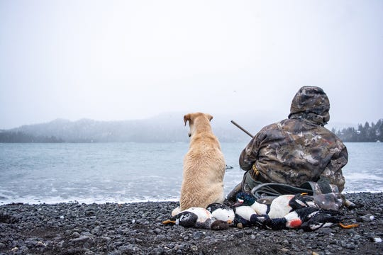 Ramsey Russell and his dog Cooper enjoy a view in Alaska while hunting.