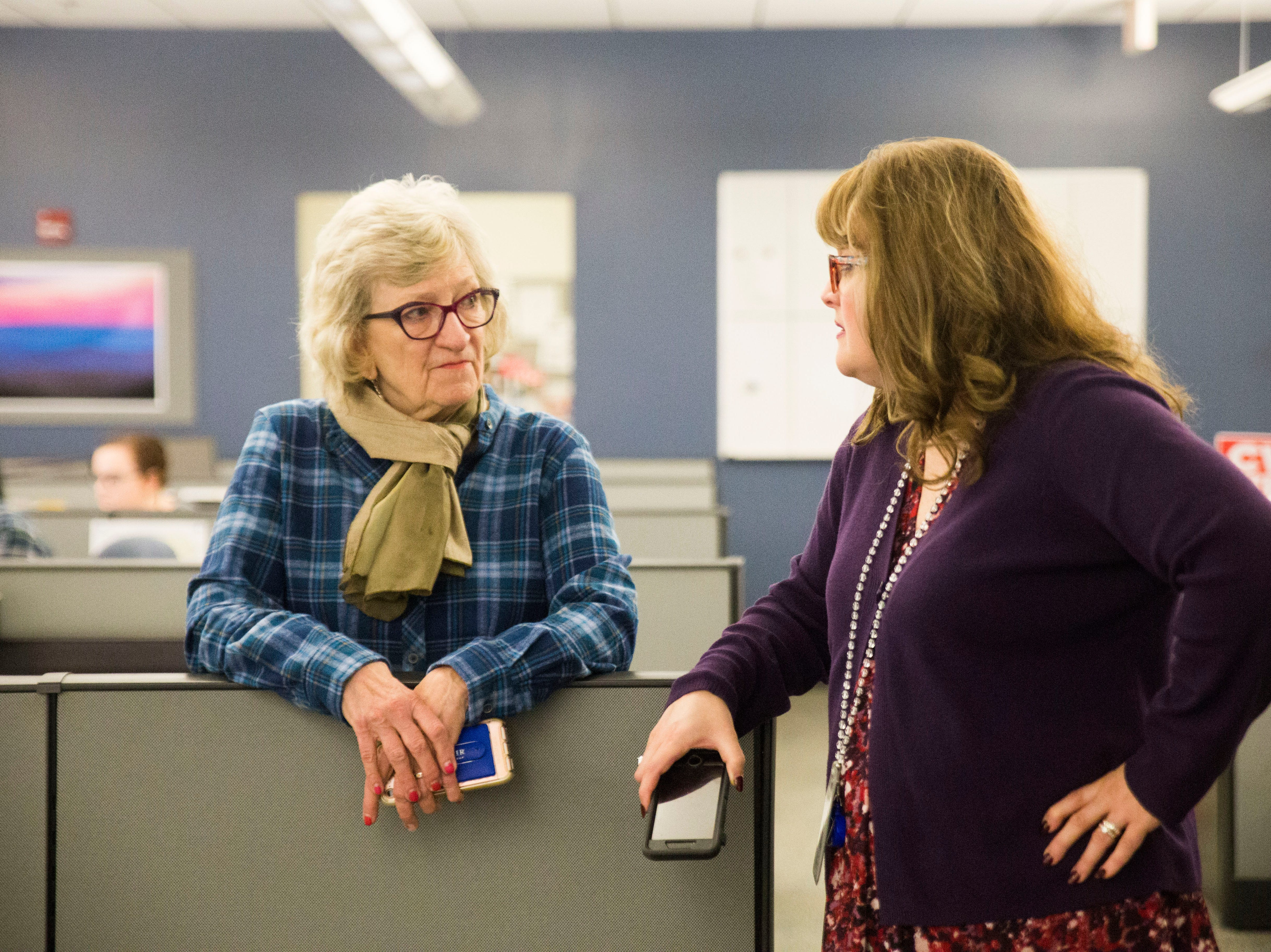Former reporter Georgiana Vines and news content strategist Amy Vellucci speak as the newsroom celebrates the retirements of Mary Constantine, Jack Lail and Michael Patrick on Wednesday, January 2, 2019.