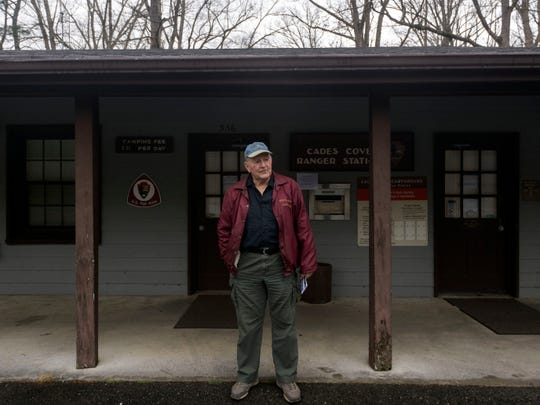 "David Knight waits outside the Cades Cove ranger station after no one answered the door when he knocked. ""I can hear people talking inside,"" said Knight on Wednesday, January 2, 2019. Knight is camping overnight while traveling to Florida in his R.V. ""I've got onboard water, batteries, solar panels. I can dry camp,"" he adds when he learned that the campground was open but the facilities were closed. Knight eventually came across a ranger 20 minutes after he arrived."
