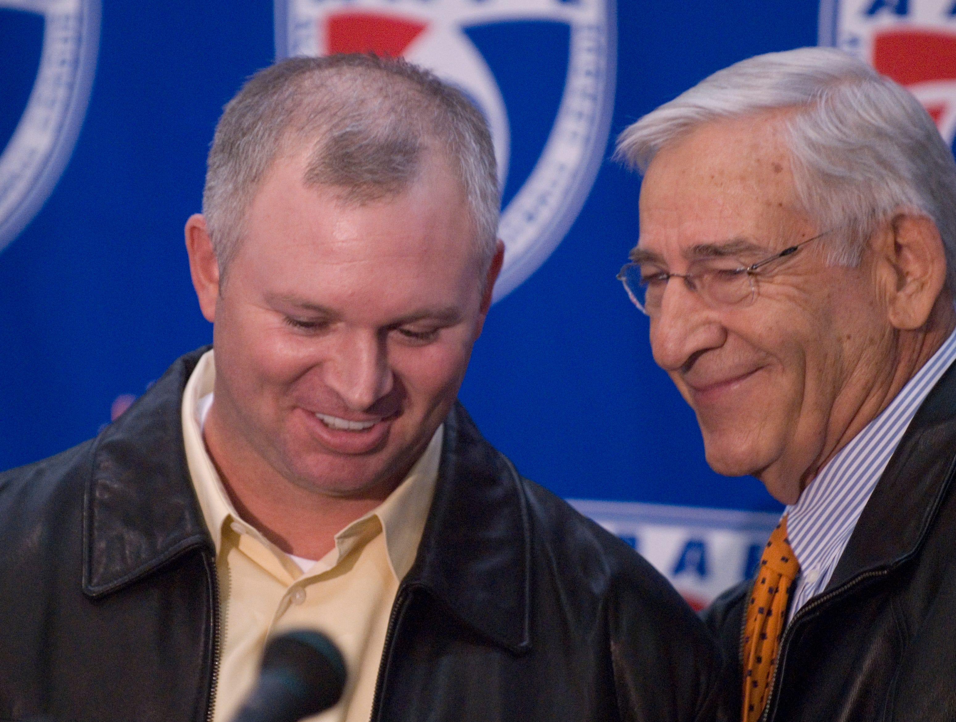 Retired University of Tennessee athletics director Doug Dickey, right, introduces Andy Kelly, center, as the coach of Team Tennessee of the All American Football League following the super combine at Neyland Thompson Center.  Kelly played for UT from 1888-91 and Dickey is an executive for the new league. 12/06/07