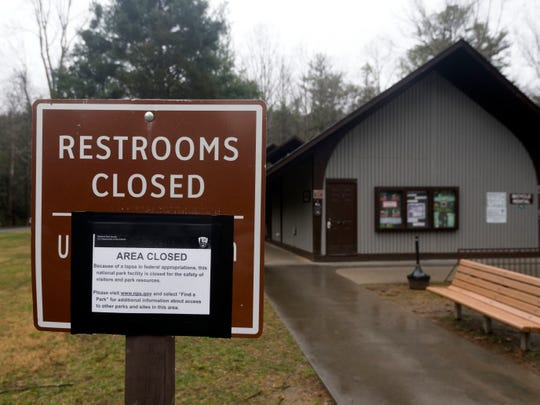 A sign informs visitors in the Great Smoky Mountains National Park that part of Cades Cover is closed as a result of the government shutdown.
