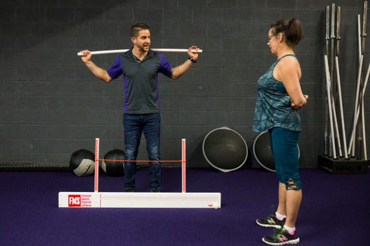 Leesa Fisher works out under the guidance of trainer and co-owner Jay McDonald at an Anytime Fitness location in Loudon Wednesday, Jan. 2, 2019. Anytime Fitness is expanding in Tennessee.