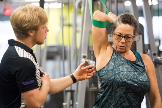 Leesa Fisher works out under the guidance of trainer Josh Hensley at an Anytime Fitness location in Loudon Wednesday, Jan. 2, 2019. Anytime Fitness is expanding in Tennessee.