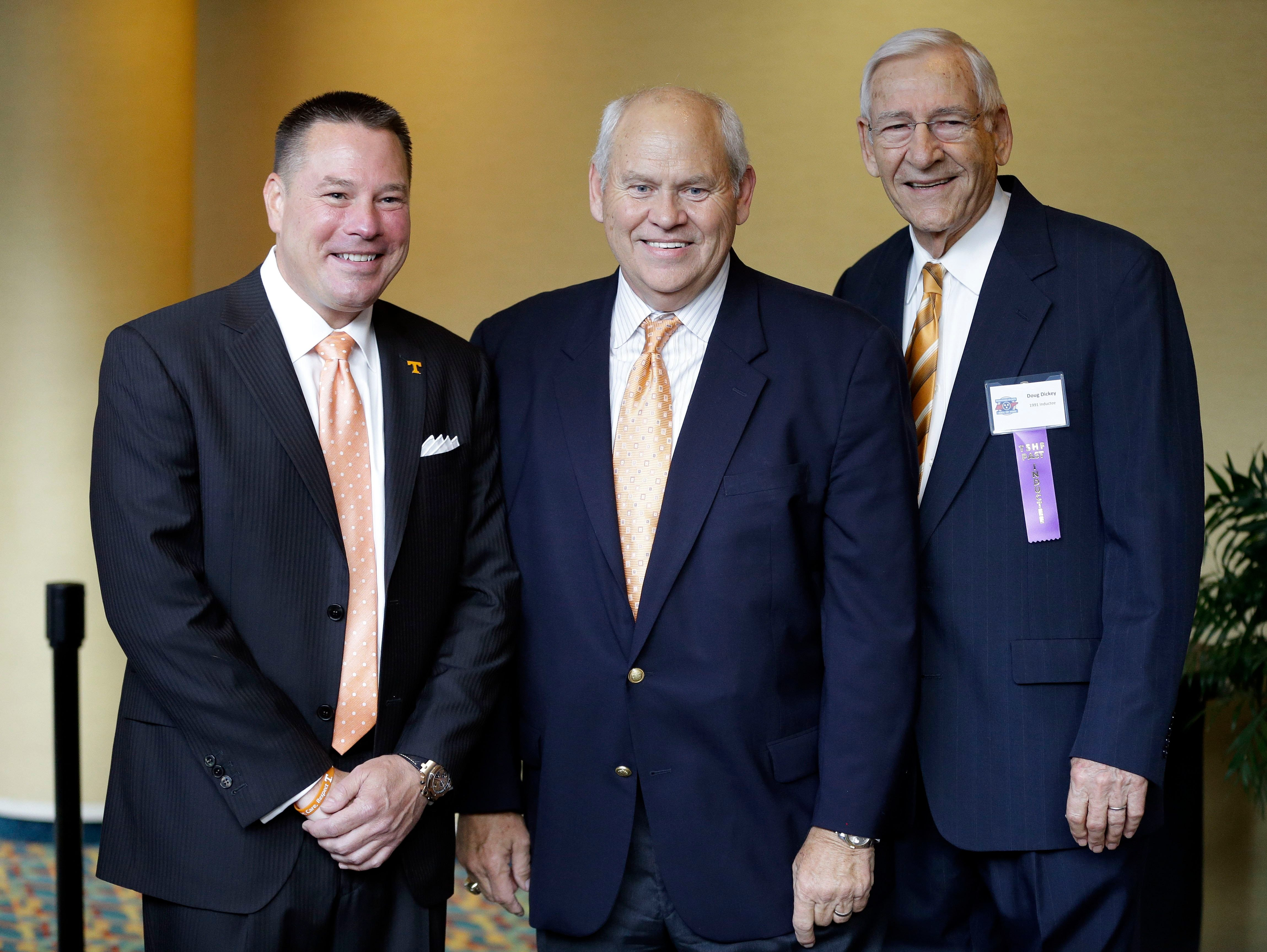 Tennessee football coach Butch Jones, left, poses with former Tennessee coaches Phil Fulmer, center, and Doug Dickey before the inductions to the Tennessee Sports Hall of Fame on  Saturday, May 17, 2014, in Nashville, Tenn.
