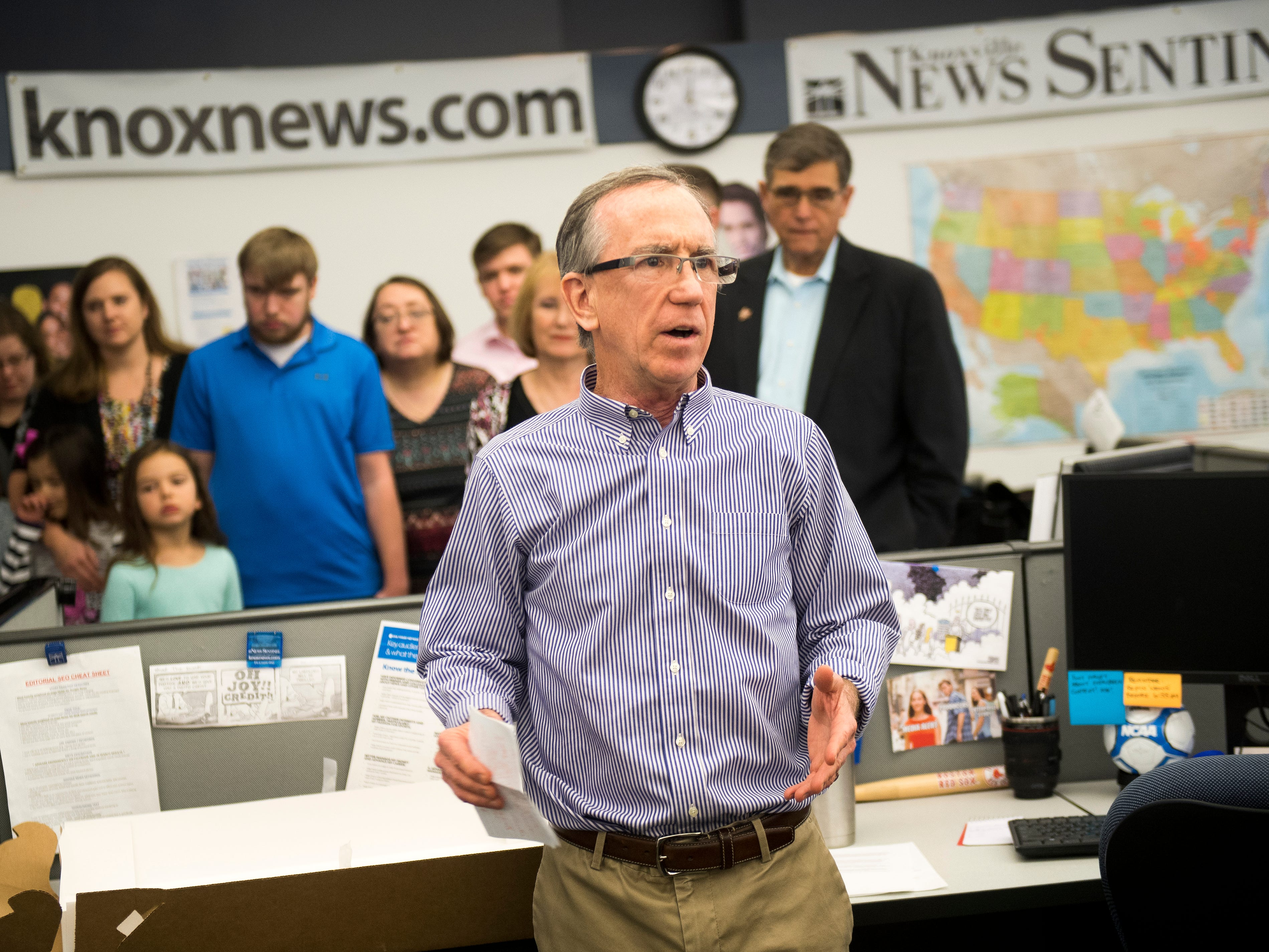 News Sentinel Executive Editor Jack McElroy, center, speaks as the newsroom celebrated the retirements of Mary Constantine, Jack Lail and Michael Patrick on Wednesday, January 2, 2019.