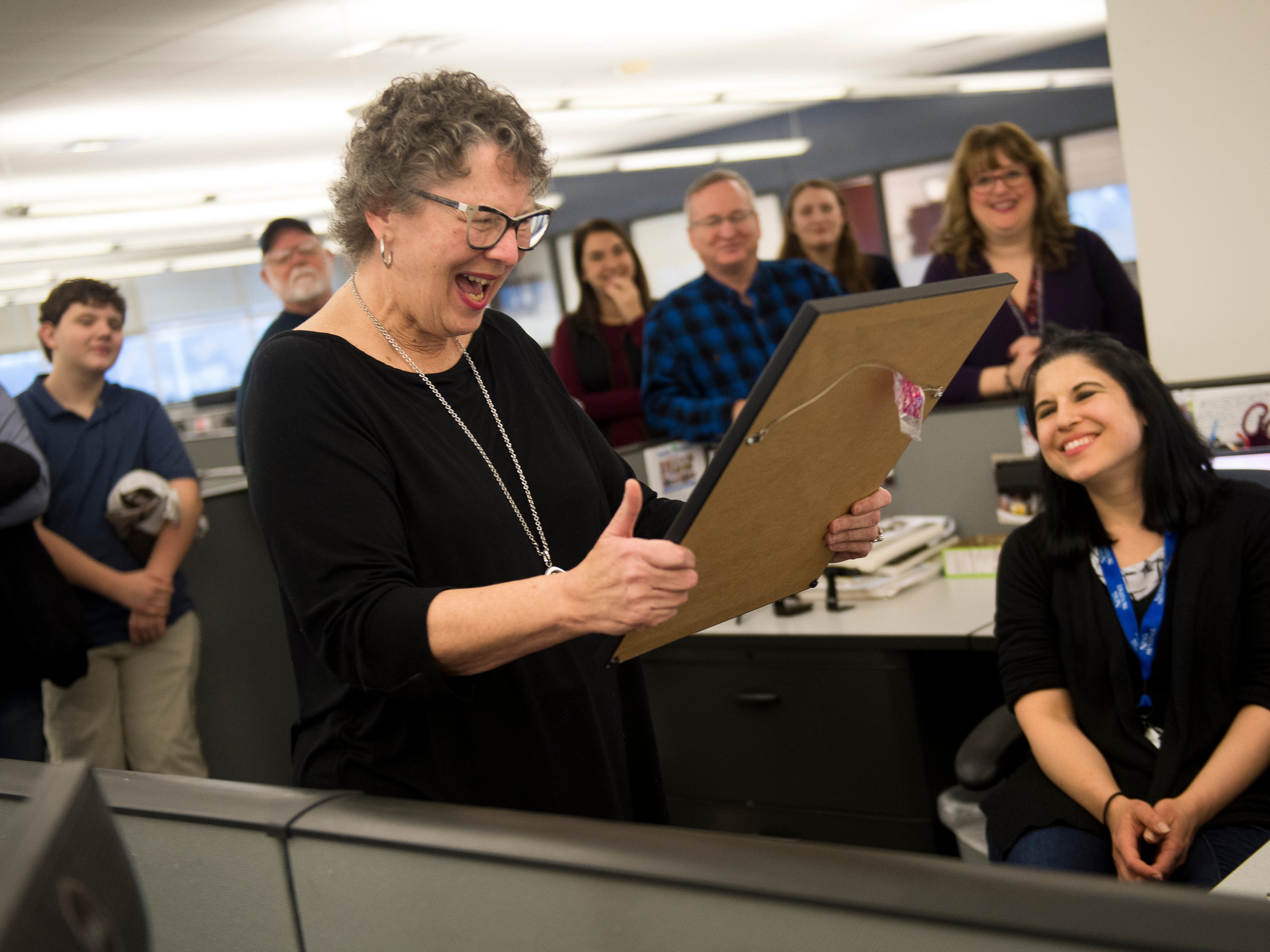 Features writer Mary Constantine reacts to her custom Charlie Daniel cartoon during a retirement party on Wednesday, January 2, 2019. The Knoxville News Sentinel celebrated the retirements of Mary Constantine, Jack Lail and Michael Patrick.