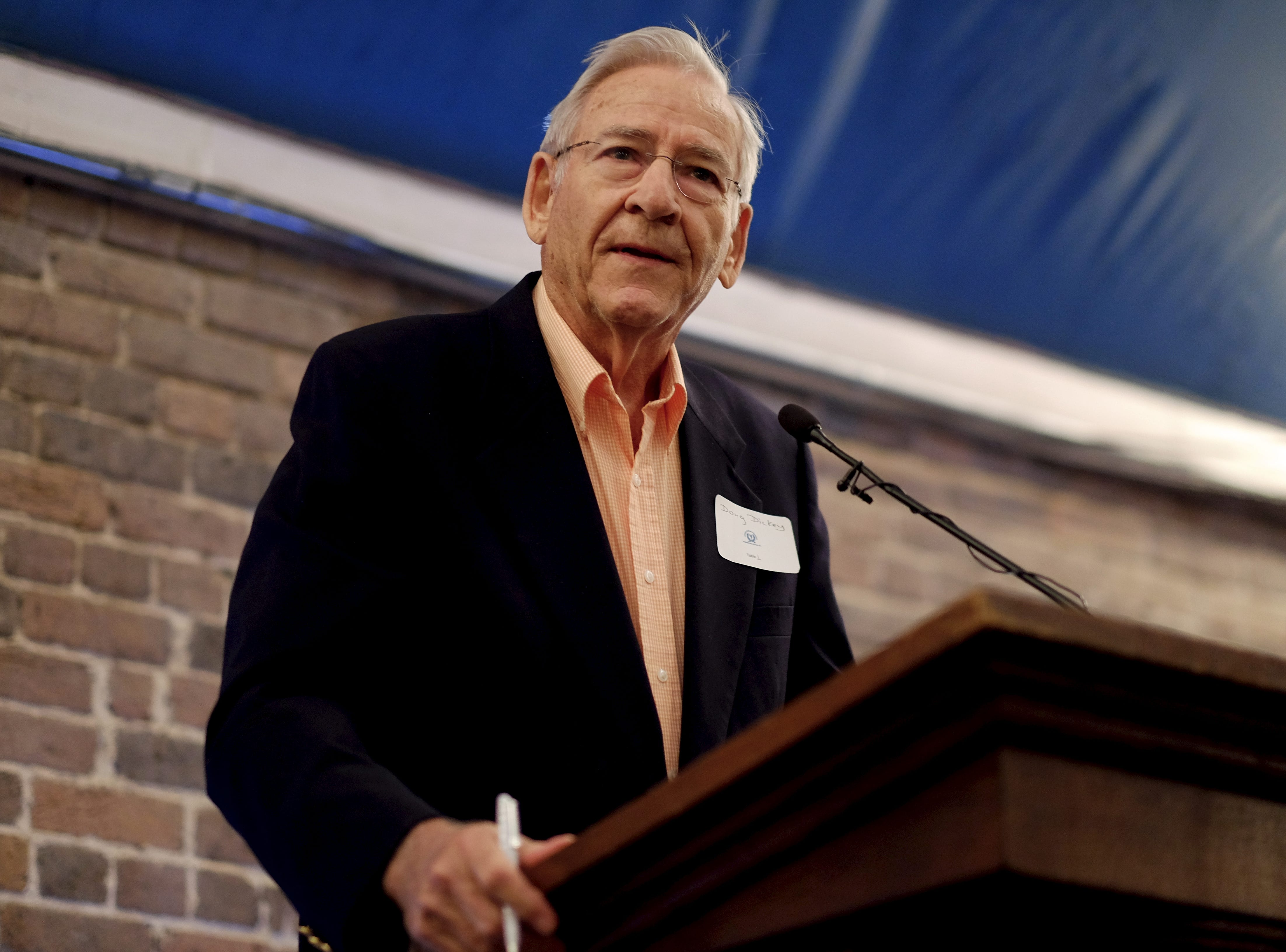 Former college football player and coach, Doug Dickey, delivers his speech to introduce Steve Spurrier as the recipient of this year's 2016 R.R. Neyland Memorial Award presented by the Knoxville Quarterback Club during the awards ceremony at the Foundry in Knoxville, on Saturday, April 16, 2016.