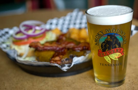 A Citra Session ale is served with the Smoky Burger and tater tots at Smoky Mountain Brewery in Turkey Creek Tuesday, March 31, 2015.
