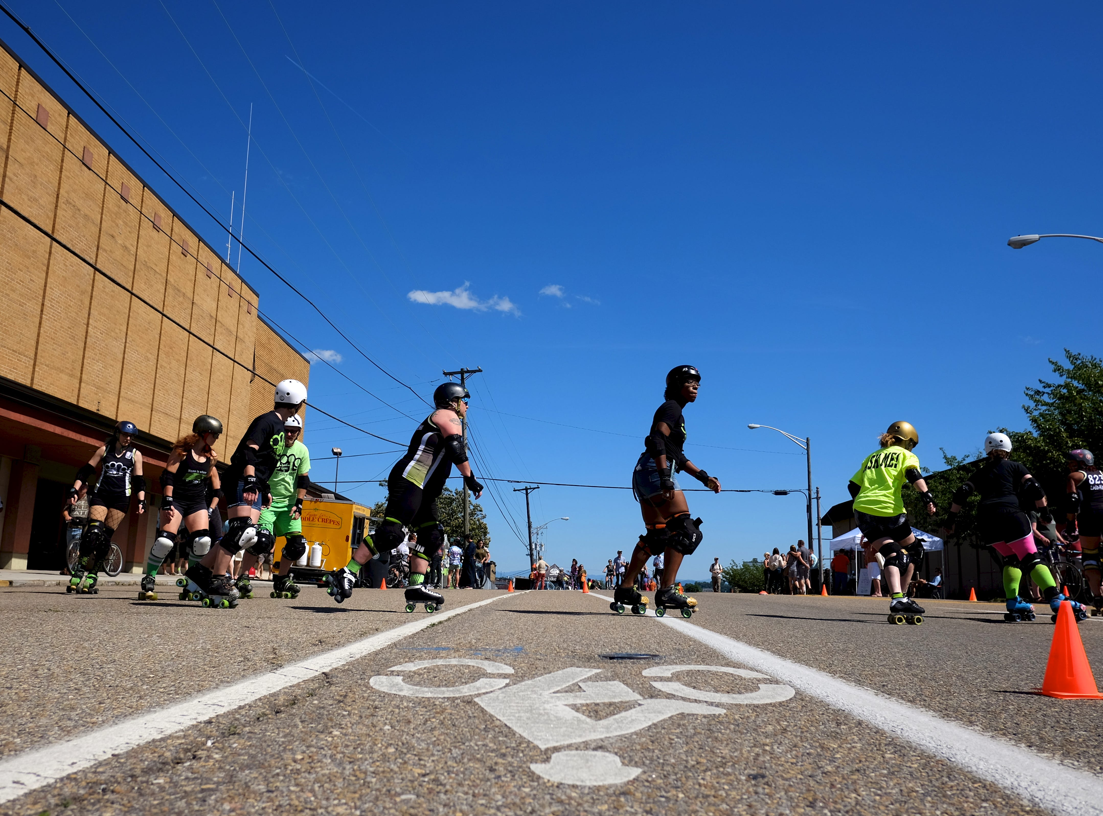 The Hard Knox Roller Girls do a demonstration during Open Streets Knoxville along Central Ave., on Sunday, May 15, 2016.