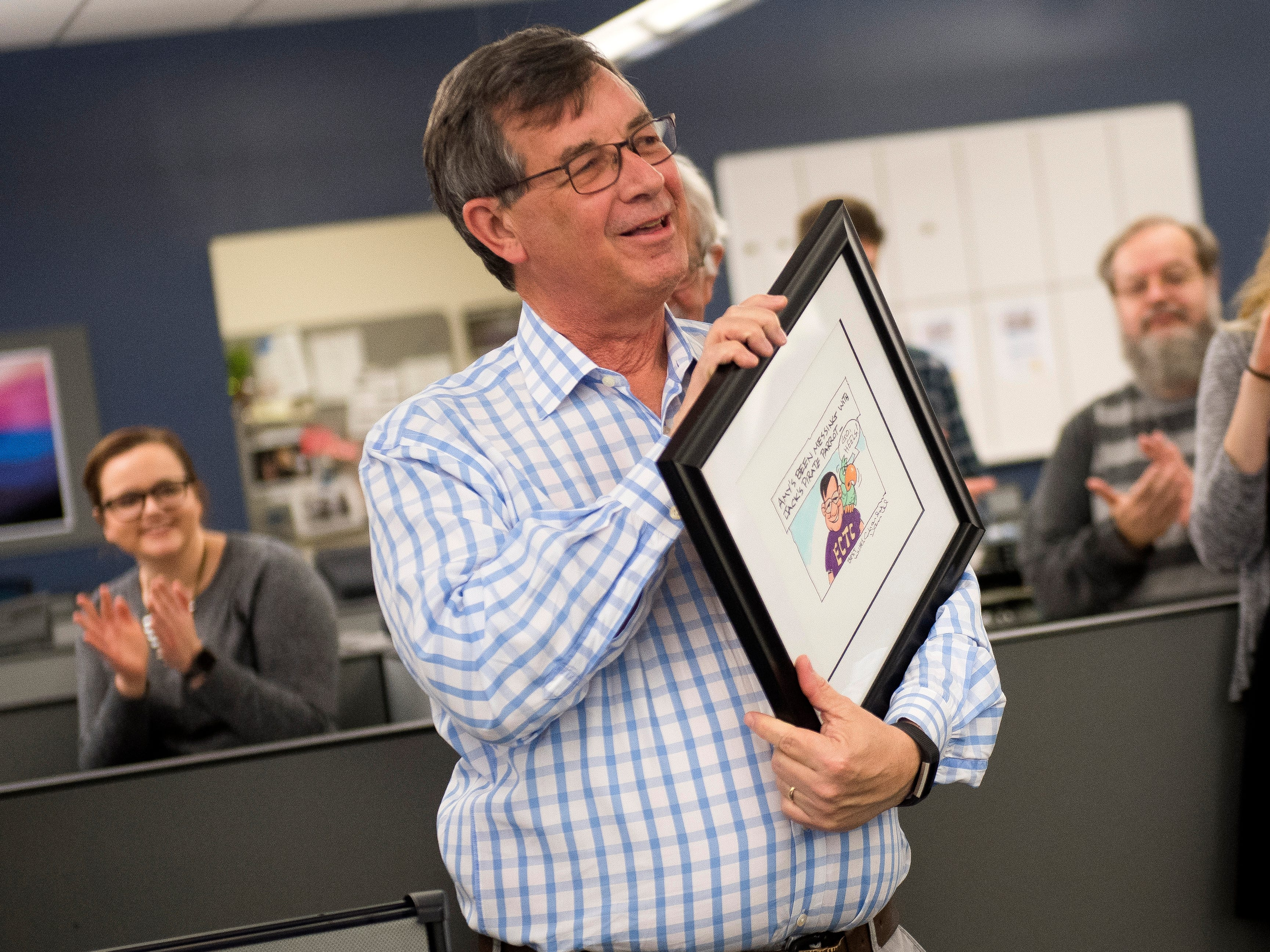 Consumer Experience Director Jack Lail reacts to his custom Charlie Daniel cartoon during a retirement party on Wednesday, January 2, 2019. The Knoxville News Sentinel celebrated the retirements of Mary Constantine, Jack Lail and Michael Patrick.