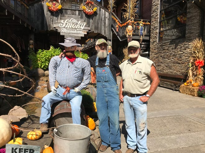 Steve Hill, right, owner of Hillbilly Landscapin', created this scarecrow for a display at The Holler in Gatlinburg. With him is friend Bruce Whaley, who works at Ole Smoky Whiskey Distillery.