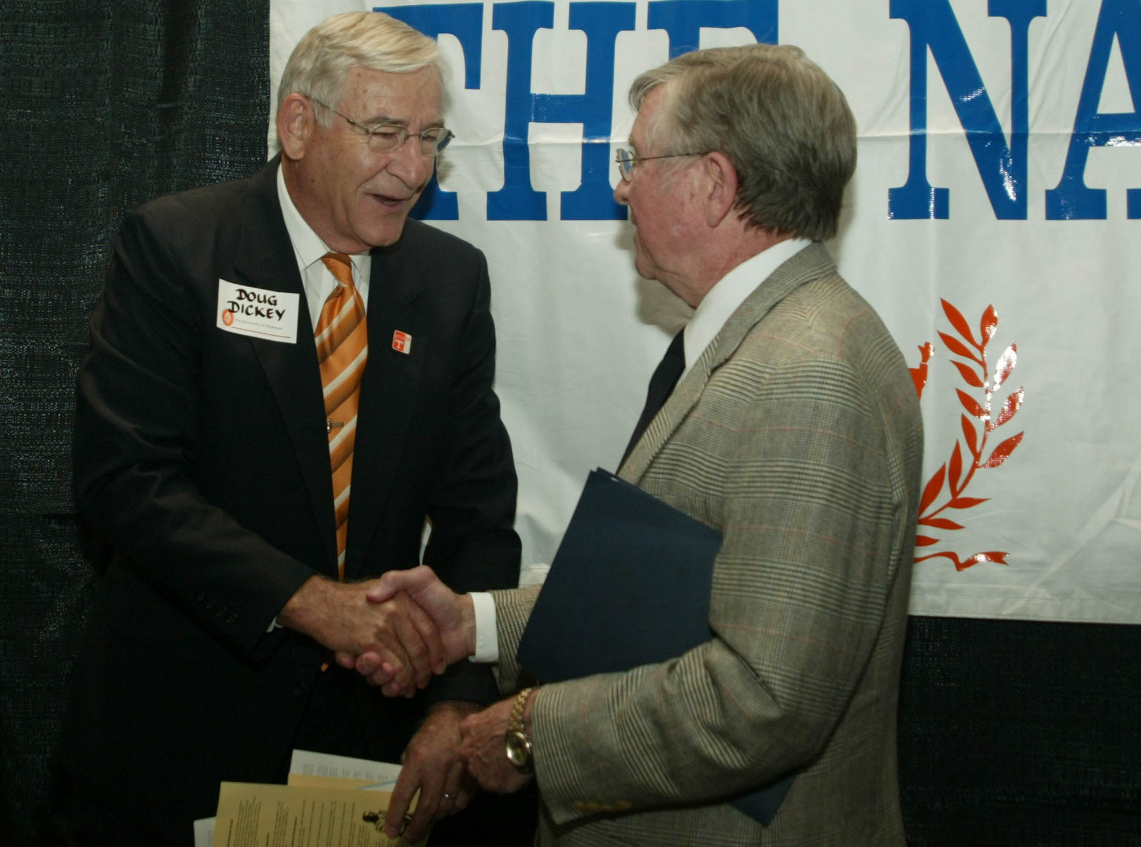 University of Tennessee Athletic Director Doug Dickey greets former UT Football Coach Johnny Majors Saturday morning at the awards banquet for the East Tennessee Chapter of the Nation Football Foundation and Hall of Fame.